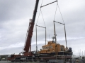 Mobile crane lifting boat.